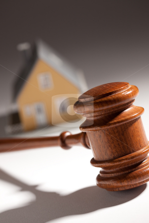 Gavel and Model Home stock photo, Gavel and Model Home on Gradated Background with Selective Focus. by Andy Dean
