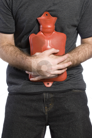 Sore Stomach stock photo, Close-up view of somebody holding a hot water bottle to soothe their sore stomach by Richard Nelson
