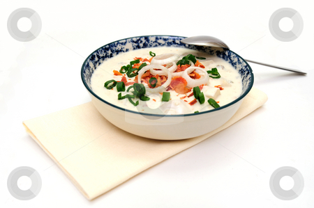 Clam Chowder New England Style stock photo, Hot bowl of New England Clam Chowder with crumbled bacon, green and white onion rings in a blue and white bowl by Lynn Bendickson