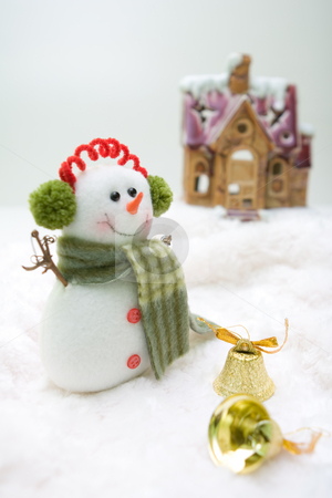 Front house snowman stock photo, Snowman with bells standing in front of the house. by Tamas Vargyasi