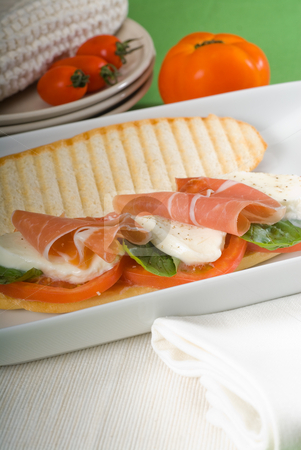Panini caprese and parma ham stock photo, Panini sandwich with fresh caprese and parma ham by Francesco Perre