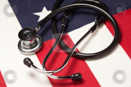 Stethoscope on American Flag stock photo, Stethoscope on American Flag with Selective Focus. by Andy Dean
