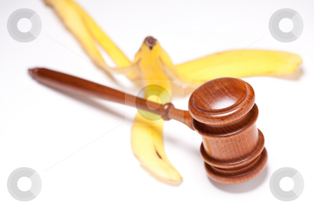 Gavel and Banana Peel on Gradated Background stock photo, Gavel and Banana Peel on Gradated Background with Selective Focus - Lawsuit Concept. by Andy Dean