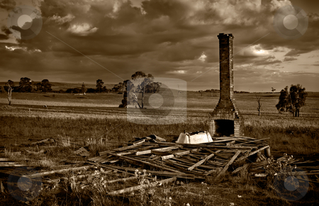 Huff n puff stock photo, Huff n puff - sepia image of when a dark storm comes over the fallen down ruins on the farm by Phil Morley