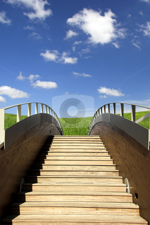 Wooden Bridge stock photo, Wooden bridge ending in a beautiful green meadow by ikostudio
