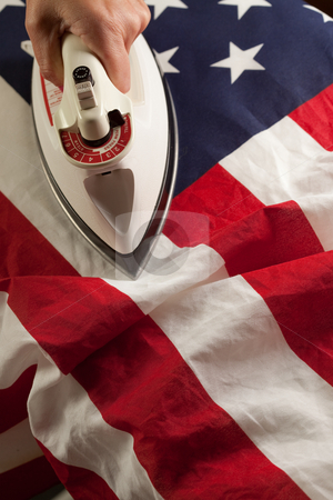 Ironing Out the Wrinkles of Flag stock photo, Ironing Out the Wrinkles in the American Flag - Conceptual. by Andy Dean
