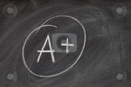 A plus grade on blackboard stock photo, A plus grade handwritten with white chalk on blackboard with eraser smudge texture by Marek Uliasz