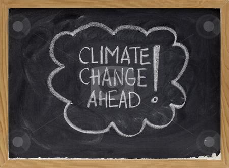 Climate change ahead stock photo, Climate change ahead - white chalk handwriting on a school blackboard by Marek Uliasz