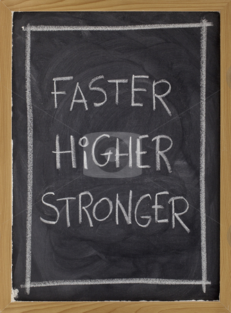 Faster, higher, stronger on blackboard stock photo, Olympic motto (faster, higher, stronger) handwritten with white chalk on blackboard by Marek Uliasz
