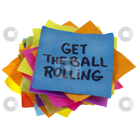 Get the ball rolling stock photo, Motivational slogan on a stack of colorful reminder notes isolated on white by Marek Uliasz