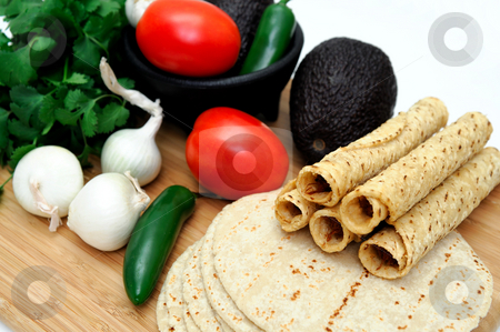Taquitos And Vegetables stock photo, Taquitos with other natural ingredients including homemade tortillas, avocados, tomatoes, small sweet onions and jalapeno chilies by Lynn Bendickson
