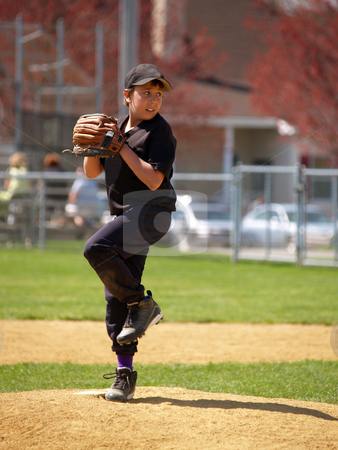 Little league pitcher stock photo, Action shot of a little league baseball pitcher on the pitching mound by Cynthia Farmer