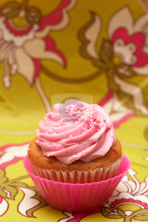 Vanilla cupcake with strawberry icing stock photo, Fresh vanilla cupcake in pink cup with strawberry icing on decorative background by Elena Weber (nee Talberg)