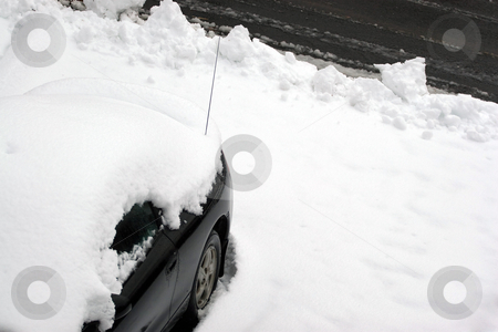 Car Snowed In stock photo, A vehicle covered in snow and snowed in just after the city plow passed the driveway. by Todd Arena