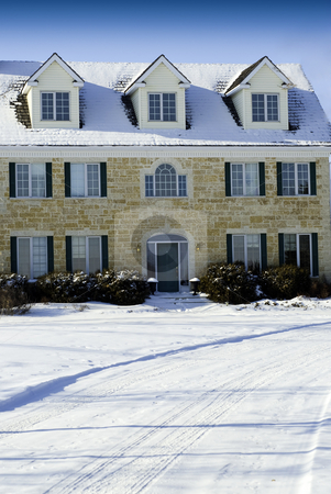 Large Stone House stock photo, A large three story house made of stones taken during the winter. by Richard Nelson