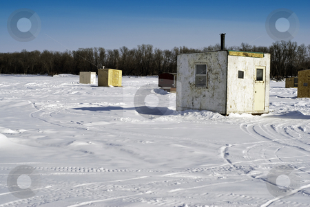 Ice Fishing Huts stock photo, Scattered shacks used for ice fishing situated on the frozen