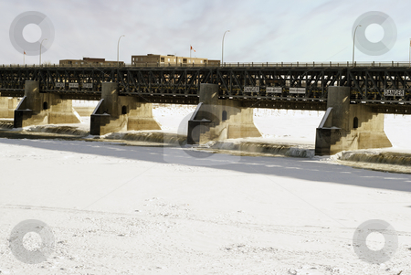 Winter Dam stock photo, An open dam with flowing water during the winter with the rest of the river frozen. by Richard Nelson