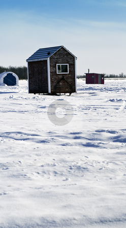 Ice Fishing stock photo, Scattered shacks used for ice fishing situated on the frozen