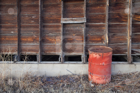 Old farm scene stock photo, Old rusty oil barrel and weathered wooden barn wall by Marek Uliasz