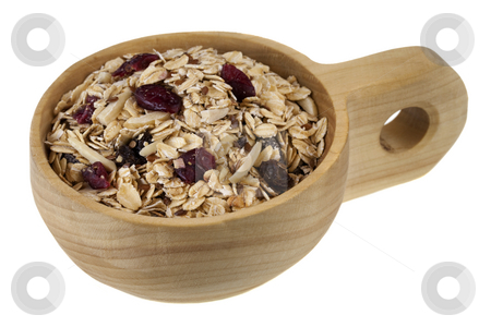 Scoop of muesli cereal  stock photo, Muesli cereal in (rolled oats with raisins, cranberries, slices almonds and flax seeds) on a rustic wooden scoop or bowl isolated on white by Marek Uliasz