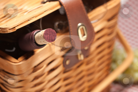 Picnic Basket, Wine Bottle and Empty Glasses stock photo, Picnic Basket, Wine Bottle and Empty Glasses on a Gingham Blanket. by Andy Dean