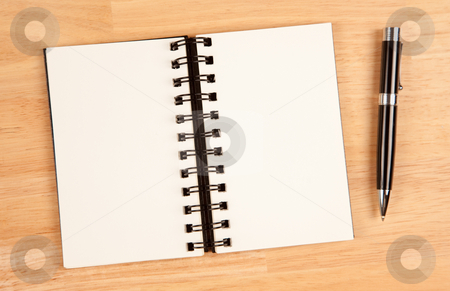 Blank Spiral Note Pad and Pen on Wood stock photo, Blank Spiral Note Pad and Pen on Wood Background. by Andy Dean