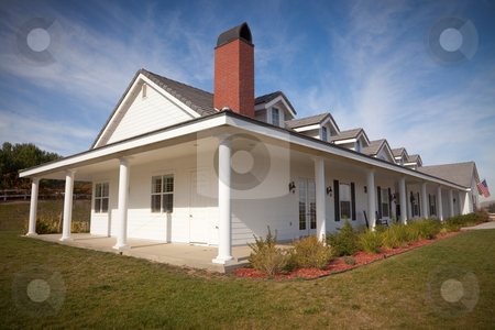 Newly Constructed Modern Home stock photo, Newly Constructed Modern Home with American Flag. by Andy Dean