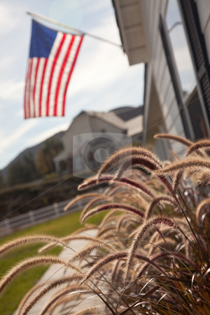 Newly Constructed Modern Home Abstract stock photo, Modern Home Yard Abstract with American Flag. by Andy Dean