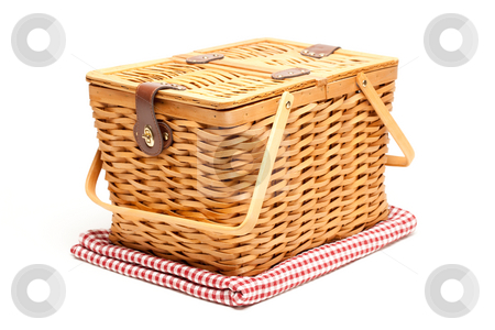 Picnic Basket and Folded Blanket Isolated stock photo, Picnic Basket and Folded Blanket Isolated on a White Background. by Andy Dean
