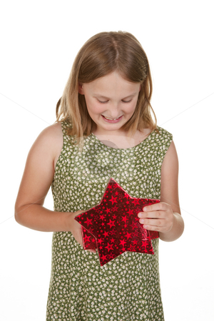 Girl child with present stock photo, A young girl opens a present isolated on white by Phil Morley