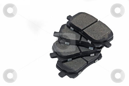 Brake Pads stock photo, Automotive parts ceramic coated  front disk brake pads by Jack Schiffer