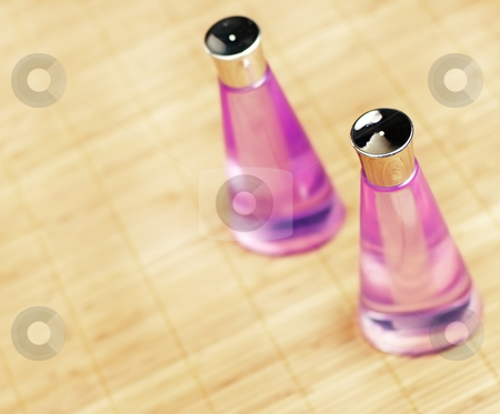 Spa Display stock photo, Brightly lit spa display on bamboo mat. by Christopher Nuzzaco