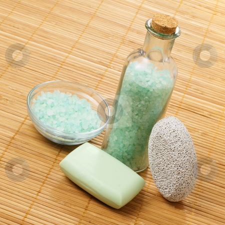 Spa Scene stock photo, Bath products on display against a bamboo mat. by Christopher Nuzzaco