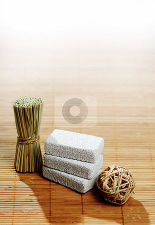 Spa Display stock photo, Brightly lit spa display on bamboo. by Christopher Nuzzaco