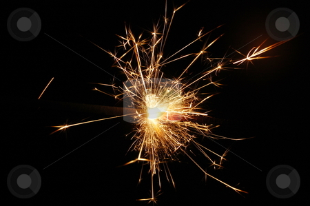Holiday sparkler stock photo, Holiday sparkler isolated on black background with copyspace by Gunnar Pippel