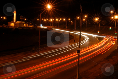 Cars at night with motion blur stock photo, Night view of the lights of moving cars. by Cienpies Design