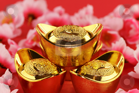 Chinese gold ingots stock photo, Front view of some chinese gold ingots surrounded by cherry blossoms on a red background by Adrin Shamsudin