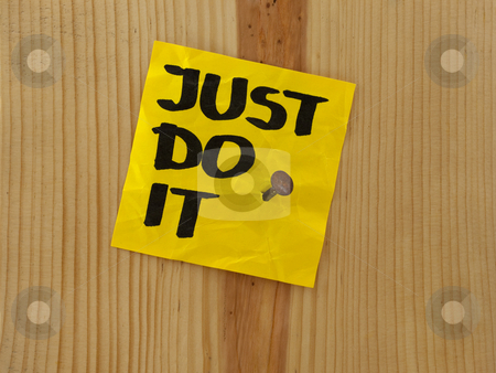 Just do it - motivational reminder stock photo, Just do it, motivational reminder handwritten on yellow sticky note and nailed to wooden wall or plank by Marek Uliasz