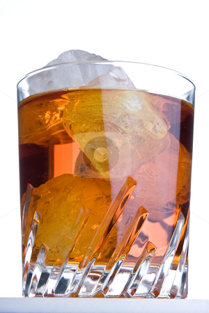On the rocks stock photo, Whisky glass with ice on the rocks by Anneke
