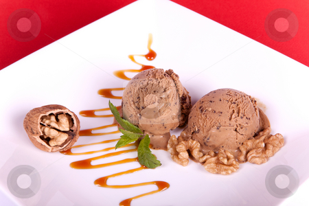 Walnut dessert stock photo, Mocha ice cream with caramel sauce and walnuts by Anneke