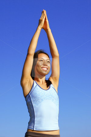 Girl Practicing Yoga In Field stock photo, Girl practicing yoga in a summer meadow. by Christopher Nuzzaco