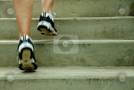 Urban Runner stock photo, Mature woman runner in the city, close up. by Christopher Nuzzaco