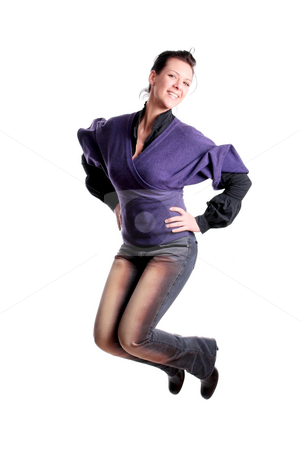 Girl jumping in the air stock photo, Attractive young girl jumping in the air by Nikola Spasenoski