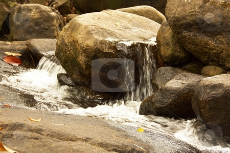 Waterfall in the jungle. stock photo, Amazing waterfall in the wet green rainforest. by Oleg Blazhyievskyi