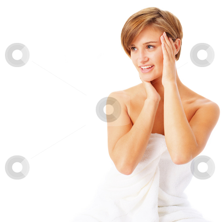 Portrait of a Woman in a Towel stock photo, Beautiful woman in a towl touching her face, from a complete series of images. by Christopher Nuzzaco