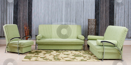 Luxury sofa stock photo, Green luxury sofa in a living room by Nikola Spasenoski