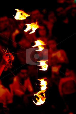 Flames stock photo, Flames burning at street performance, crowd in the background by Nikola Spasenoski