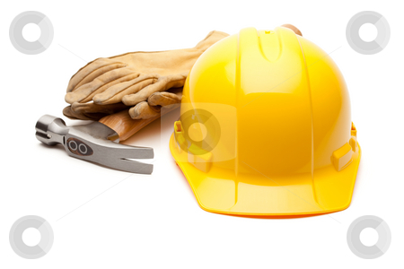 Yellow Hard Hat, Gloves and Hammer on White stock photo, Yellow Hard Hat, Gloves and Hammer Isolated on White. by Andy Dean