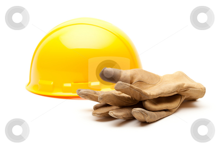 Yellow Hard Hat and Gloves on White stock photo, Yellow Hard Hat and Gloves Isolated on White. by Andy Dean