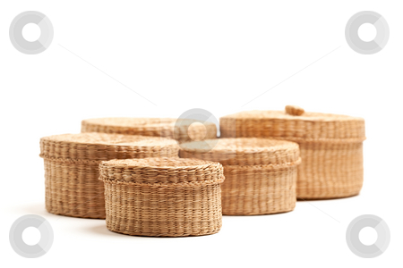 Various Sized Wicker Baskets on White stock photo, Various Sized Wicker Baskets Isolated on White - Focus is on the Front Small Basket. by Andy Dean